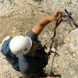 Climbing - climber with helmet - Stock Photo