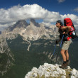 Stock Photo: Tourist with backpack in mountains