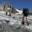 Stock Photo: Climber on mountain glacier
