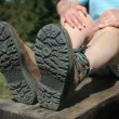 Legs in trekking boots — Stock Photo