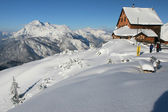 Winter in the mountains - mountain hut — Stock Photo