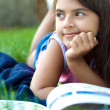 Young girl reading a book — Stock Photo