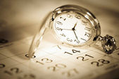 Pocket watch and calendar — Stock Photo