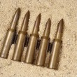 Ammunition on the sand — Stock Photo