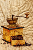 Coffee mill and beans in grunge style — Stock Photo