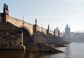 Charles bridge in the early morning fog — Stock Photo
