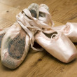 Pairs of old and new ballet shoes — Stock Photo