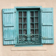 French window with blue shutters — Stock Photo #2429790