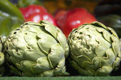 Artichokes and peppers — Stock Photo