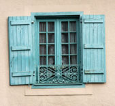 French window with blue shutters — Stock Photo