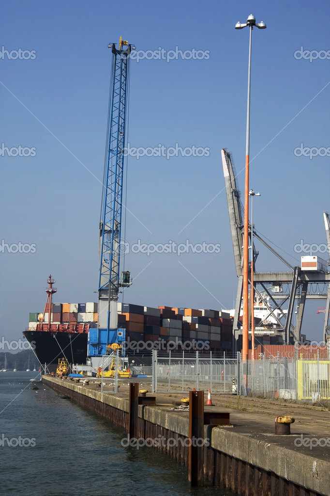Container ship emerging from Southampton docks  Stock Photo #2441361