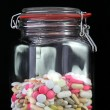 Pills in a glass jar — Stock Photo