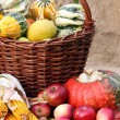Pumpkin and fruits in basket — Stock Photo