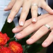 Stock Photo: Rings on young marrieds hands