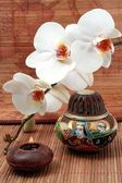Orchid flower and candle — Stock Photo