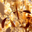 Chandelier with gold mistletoe — Stock Photo
