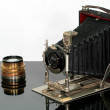 Historical photo camera with old lens — Stock Photo