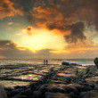 Sunset on the rocky island - Stock Photo