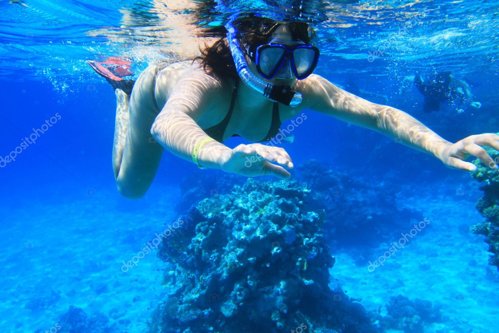 Young woman snorkeling near Tiran Island in Red Sea  Stock Photo #2632172