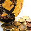 Amphora with coins — Stock Photo