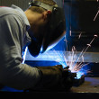 WELDING STEEL AND SPARKS - Stock Photo