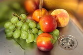Washing fruits — Stock Photo