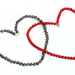 Coral, pearl necklace as heart - Stock Photo