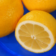 Lemon on blue plate — Stock Photo
