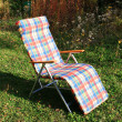 Chaise-longue, deck chair in garden — Stock Photo #2288440