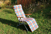 Chaise-longue, deck chair in garden — Stock Photo