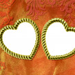 Gold heart-shaped frame on an organza — Stock Photo