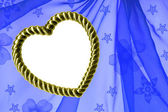 Gold heart-shaped frame on organza — Stock Photo