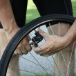 Inflating a bike tire — Stockfoto