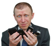 Businessman with cell phones — Stock Photo