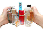 Hand gathering in bottles of perfume — Stock Photo