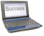 "A laptop with a word ""Success"" — Stock Photo"