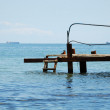 Rusty pier in water — Stock Photo #2639388