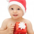 Baby in santa claus cap with gift — Stock Photo