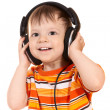 Smiling baby with headphones - Stock Photo