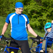 Father with son in bicycle chair — Stockfoto