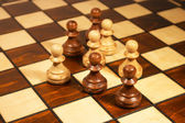 Chessmen on the chessboard — Stock Photo