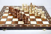 Two lines of chessmen on chessboard — Stock Photo