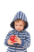 Amazed baby with red apple — Stock Photo