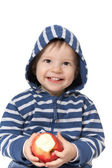 Laughing baby with red apple — Stock Photo