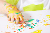 Painting baby hand — Stock Photo