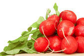 Bunch of radishes on wooden plate — Stock Photo