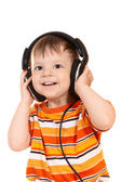 Smiling baby with headphones — Stock Photo