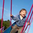 Stock Photo: Laughing baby on the swing