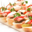 Canapes with fish — Stock Photo
