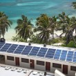 Beach with a building with a solar panel — Stock Photo #2262844